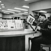 Uniformed Man reading Road Atlas